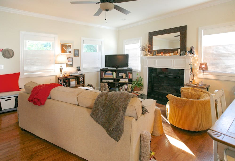 Living room with gas fireplace and ceiling fan