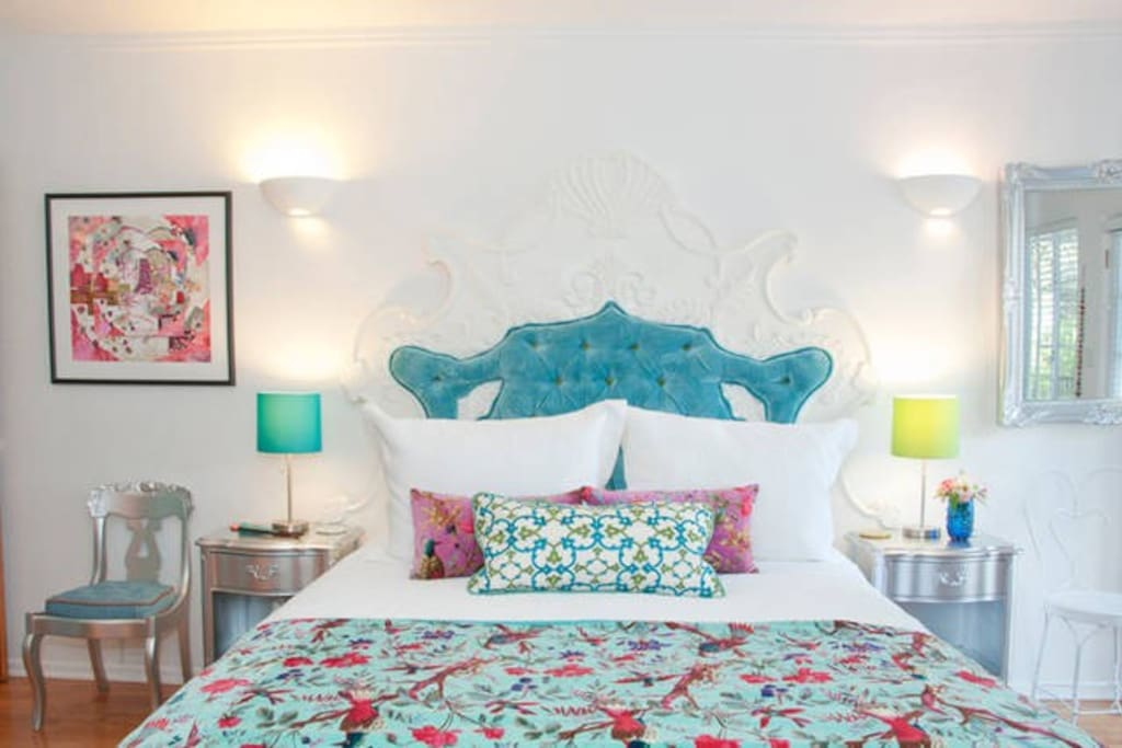 A brand new King Size Bed, artistly upholstered.