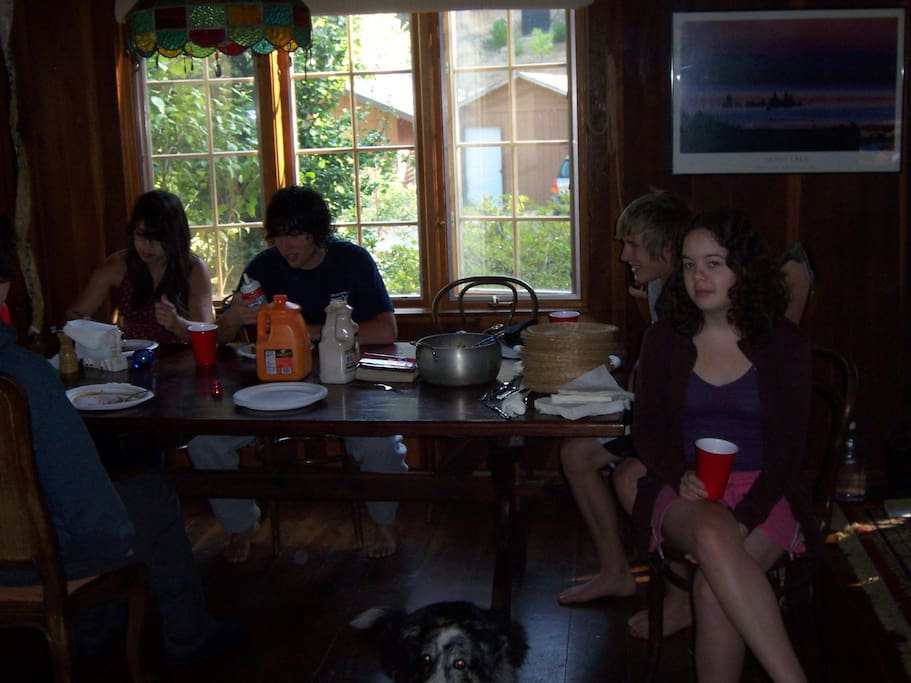 crowd around the large dinning table