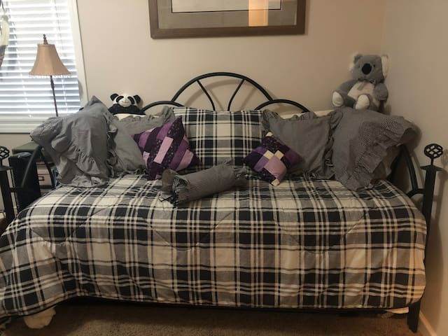 Guest bedroom 1 set up as single bed; trundle bed is stored below.