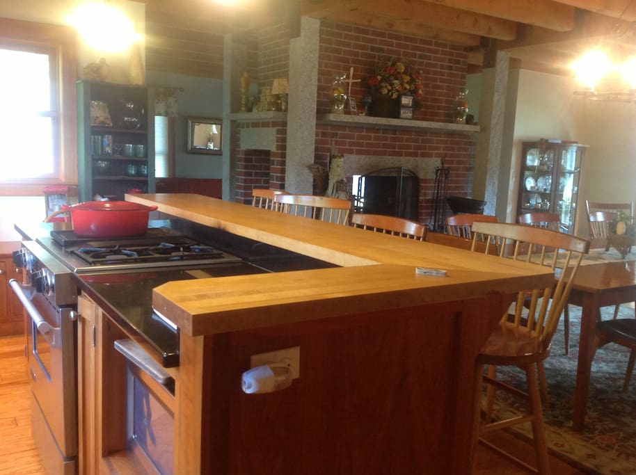 Kitchen: island/open to DR, double sided fireplace opens on DR and LR