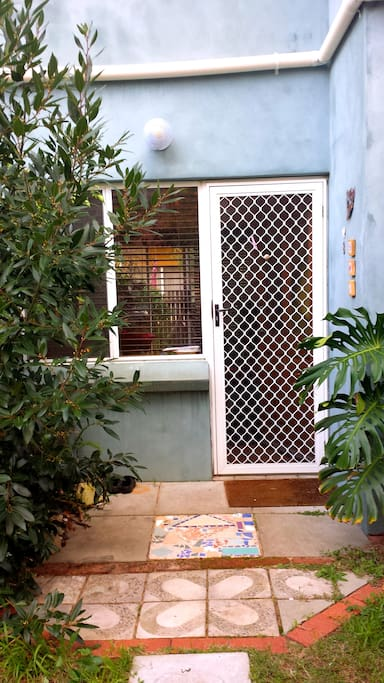 Front door approach with bay tree