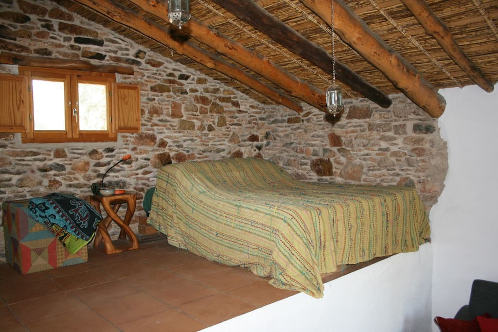 inside the casita: showing the comfortable double bed and the renovated roof and stone work