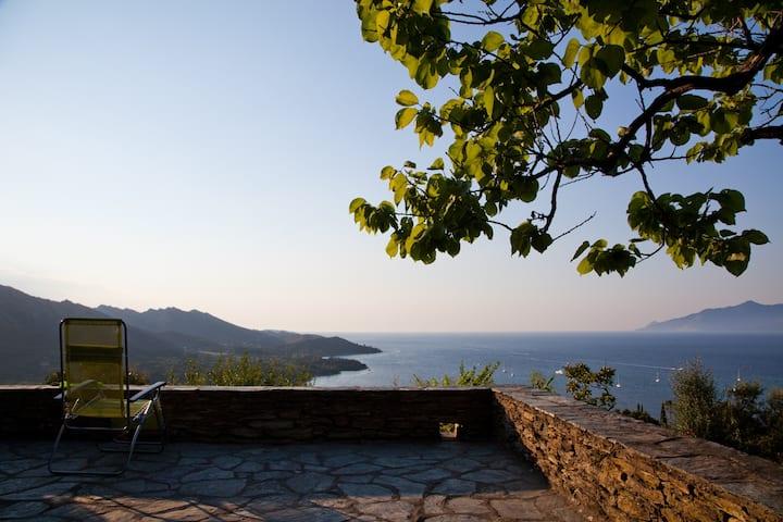 Stone villa overlooking town, sea and mountains