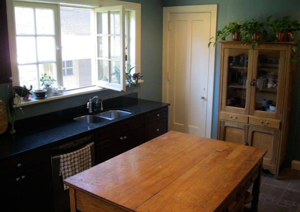 Fully remodeled kitchen with black granite counters, ceramic floor, a 5 burner gas stove, and an original home economics table.  We have tons of cooking supplies availbe for everyone - from crockpots to meat slicers.   We love to entertain.