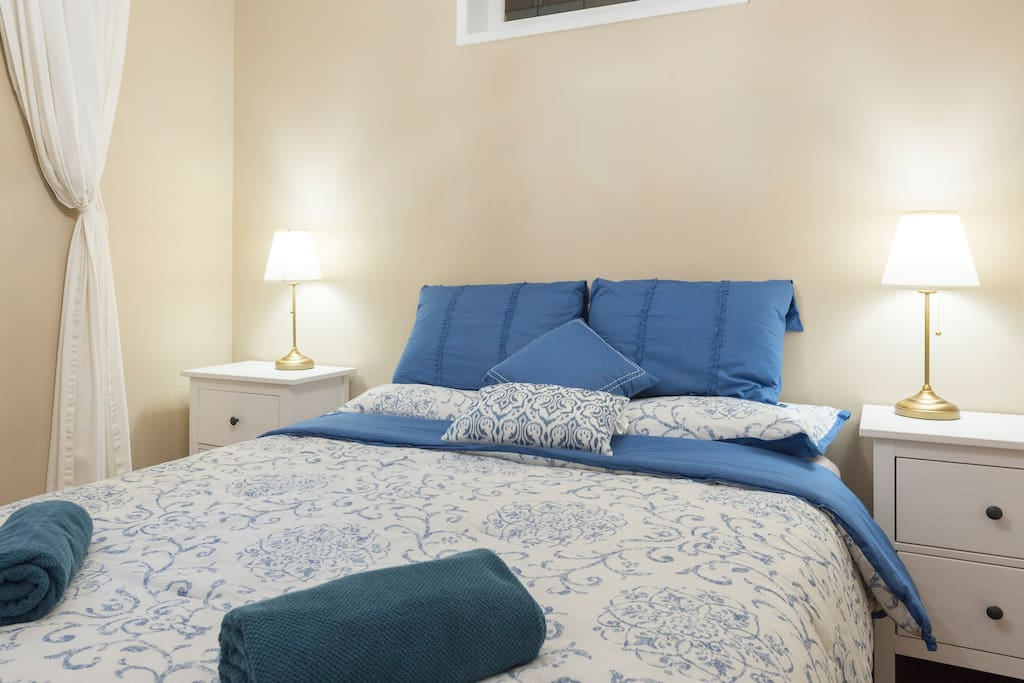 Master Bedroom with 2 bedside tables and lamps. Large wardrobe with hangers.