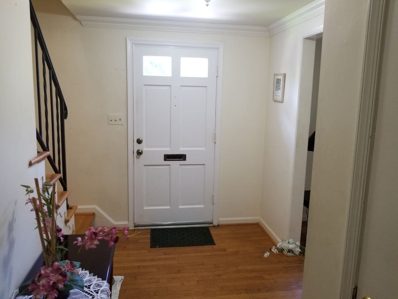 Entrance to home that leads to kitchen or upstairs.