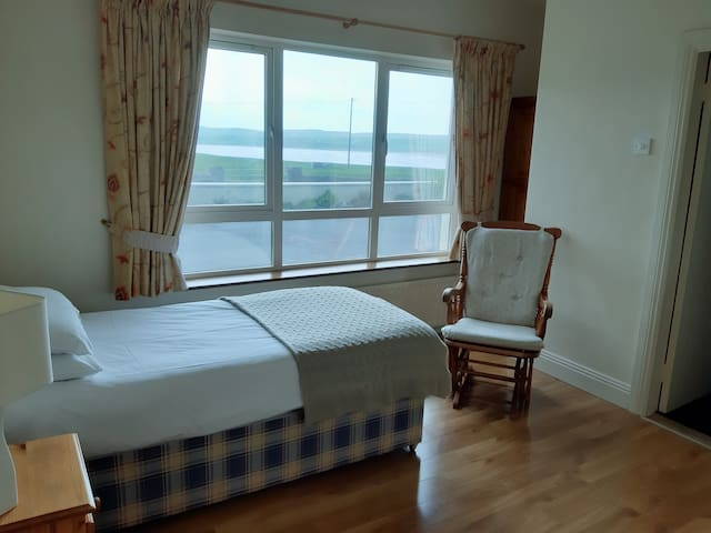 Bedroom with view of the golf course and beach.