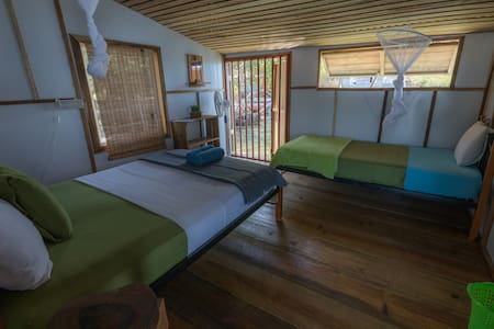 Cabinas Over The Water. Double size bed $ twin size bed, shared bathroom and shower with amazing view on the bay.