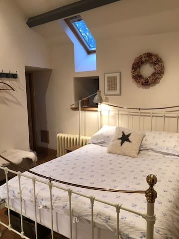 With two steps up, the  Boot Room is relaxed and welcoming with the original perlins giving it a cosy cottage feel. It has been fitted to the highest standards using local quality materials.