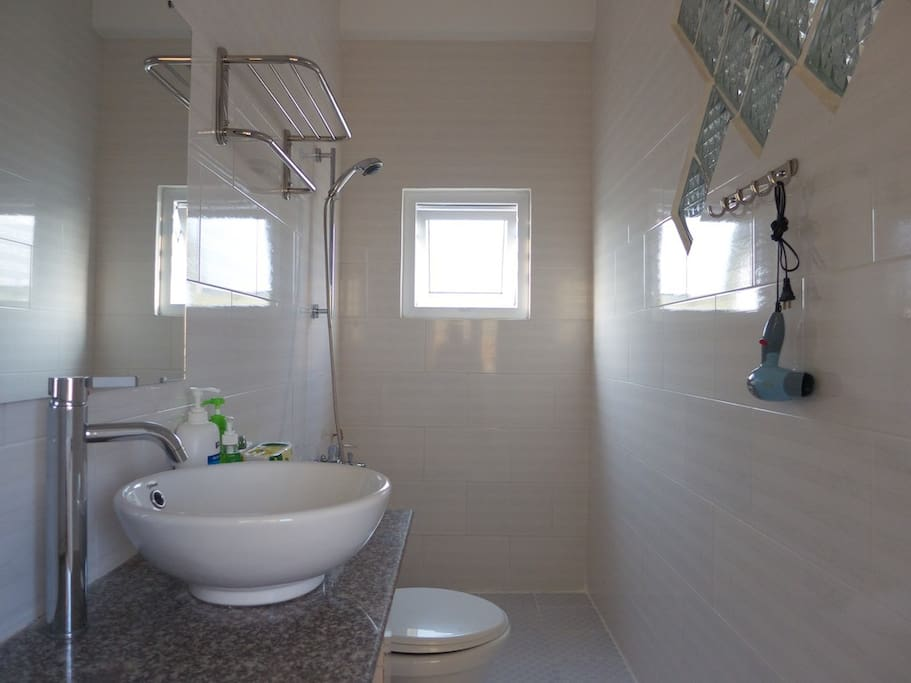 Clean bathroom with toiletries and hairdryer