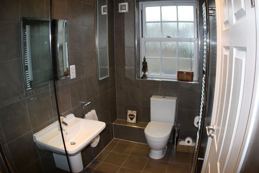 "The Double Bedroom En-suite bathroom with ""waterfall"" shower"