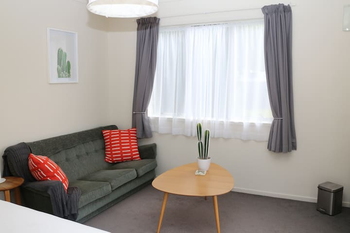 Inside your cabin/studio - modern, relaxed atmosphere with a vintage 70s feel. The cabin is spacious with couch and coffee table for relaxing. If extra guests  are staying. Air mattress, floor mattress or cot can be placed in the room