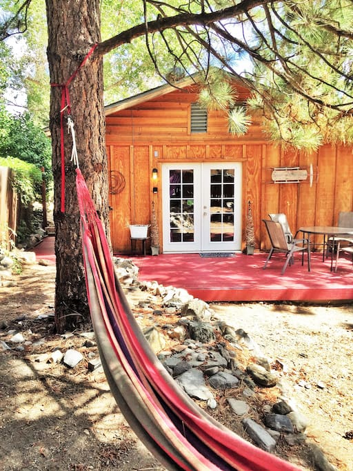 The Hideaway's deck and main entrance, facing the backyard of the property. And hammock!