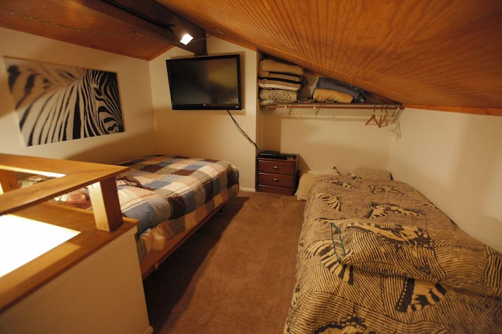 """Loft Bedroom- Sleeps 4!  55"""" mounted HDTV for Movies/Video Games/Local Channels for the kids!"""