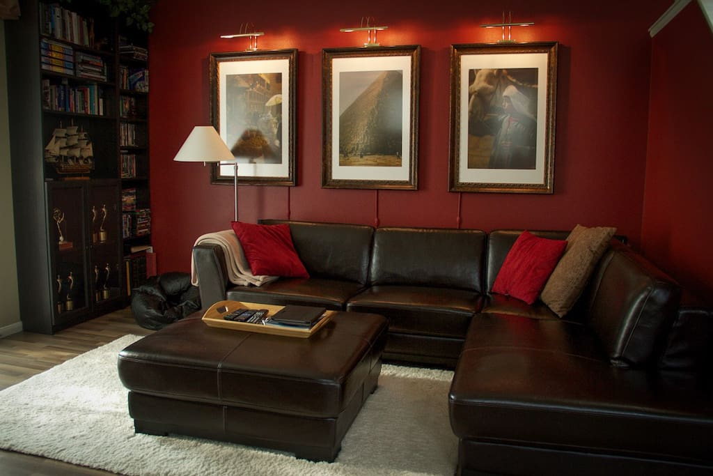 Relax on the leather sectional and pick a good book or DVD from the bookshelf.