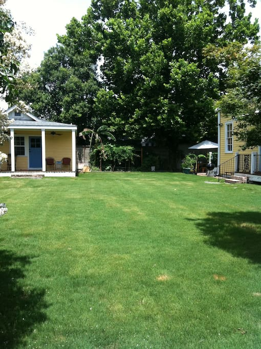 Look at how big this yard is! It's on two lots so there is plenty of space to hang out. The yard is shared but you are more than likely not to run into anyone on account how much space there is.