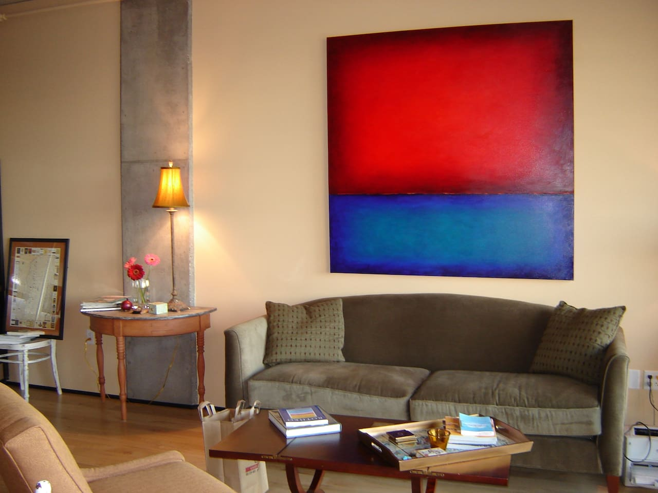 Living room with big art and small flowers.