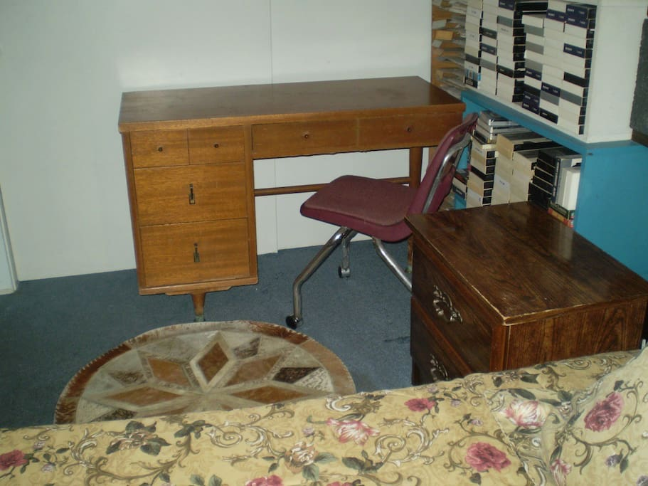A desk is available for the guest's use.