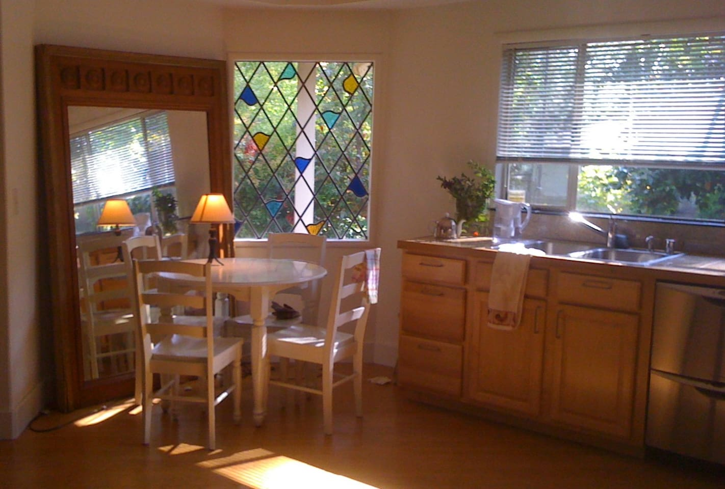 the European style kitchen with small dining table is part of the part of the large loft-like space