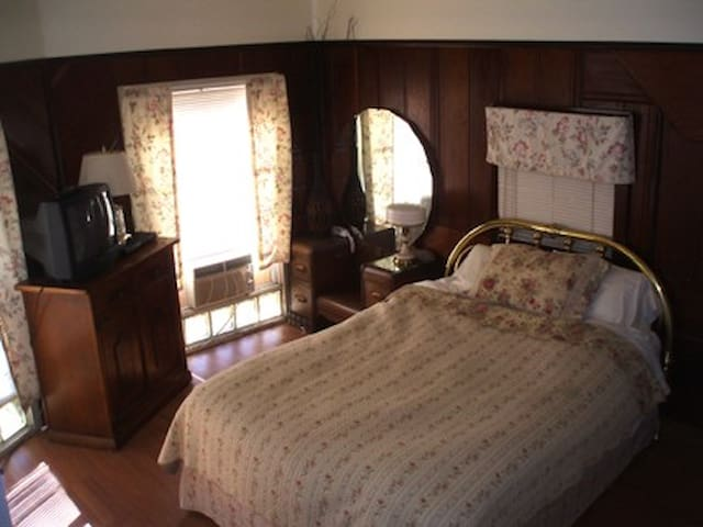 antique and chic with redwood paneling - room 7