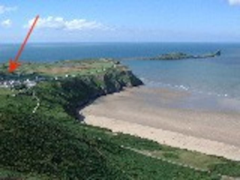 View from Rhosilli Downs overlooking The Worm ( arrow depicts cottage)