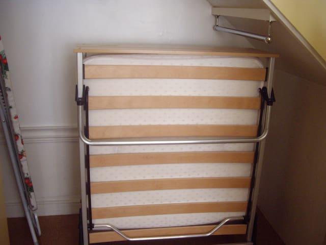 Foldaway bed stowed away