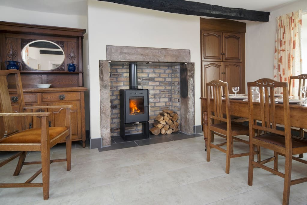 The kitchen has a wood burning stove and underfloor heating as well as everything you need to make yourself at home.