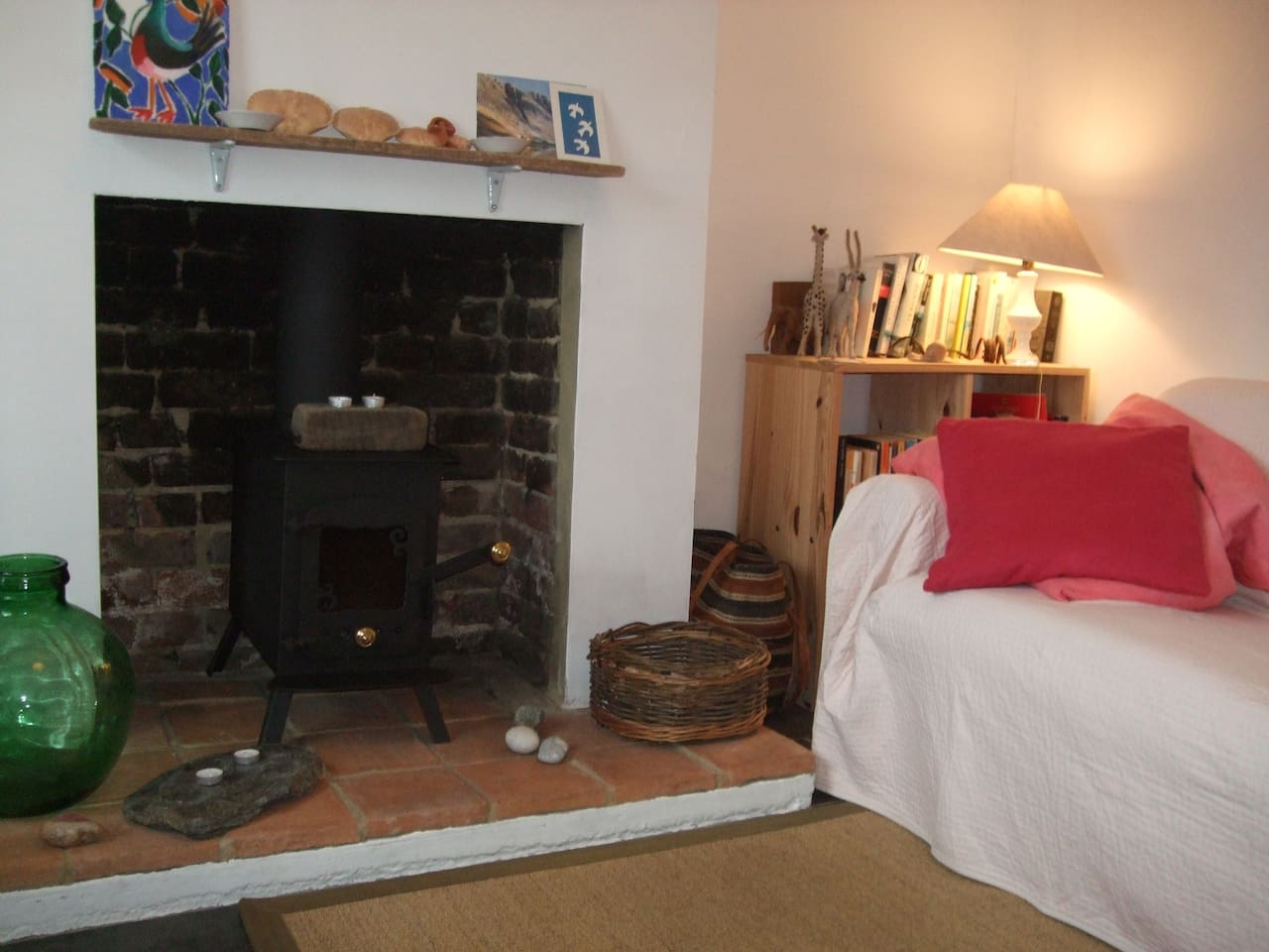 Cosy living room with woodburner. This fisherman's cottage is 3 doors from the beach and harbour. Perfect for summer but you can hunker down by the fire for a lovely winter break too.
