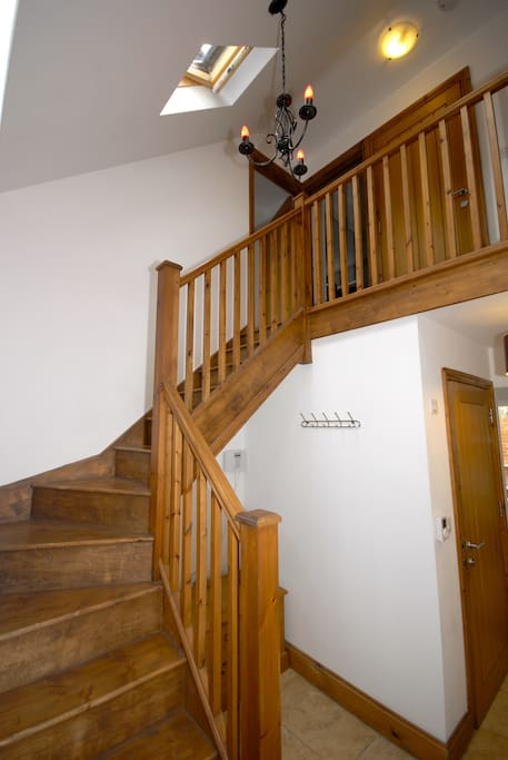 The stairway and landing that leads up to your bedroom and bathroom