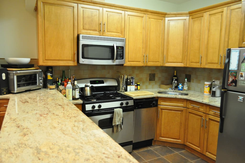 Full kitchen with microwave and dishwasher.