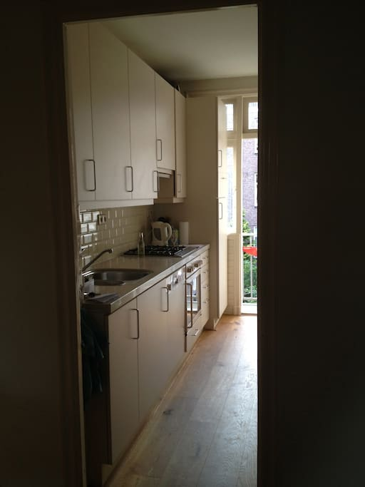 Fully equipped kitchen with access to balcony