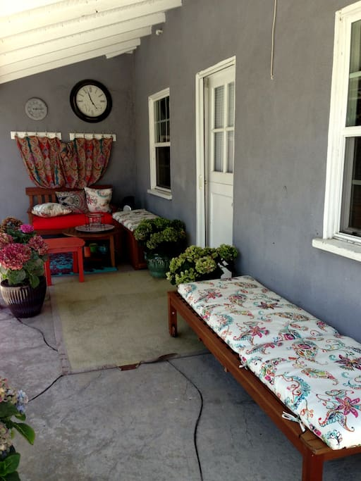Cozy patio for a relaxing afternoon.  Read a book, relax with a glass of wine and enjoy!