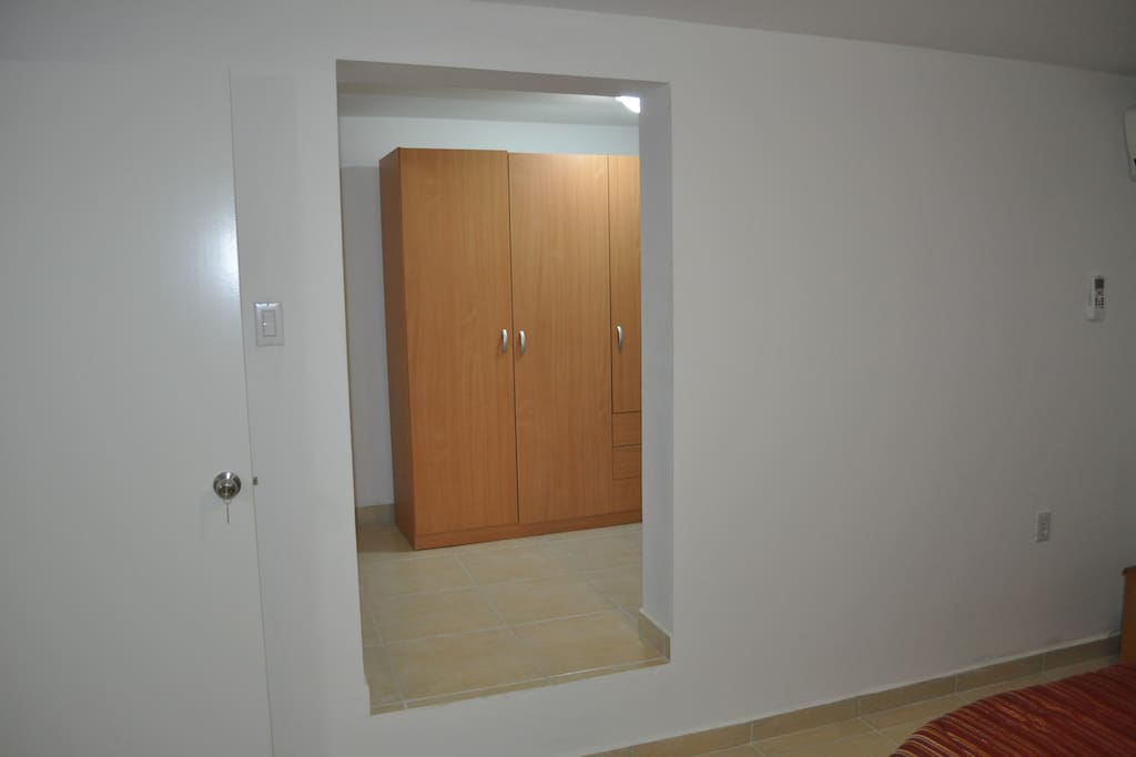 Small room adjoining the first bedroom, with closet and baby bed.