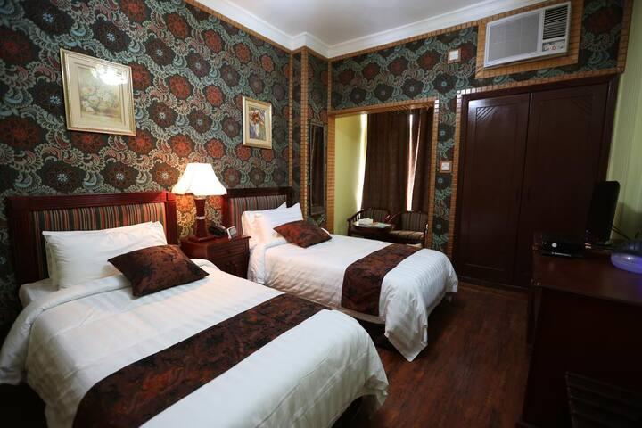 Twin Room at Moon Plaza Hotel