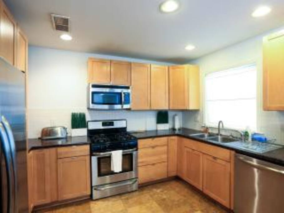 Kitchen is has full appliances. Plus built in stackable washer and dryer!