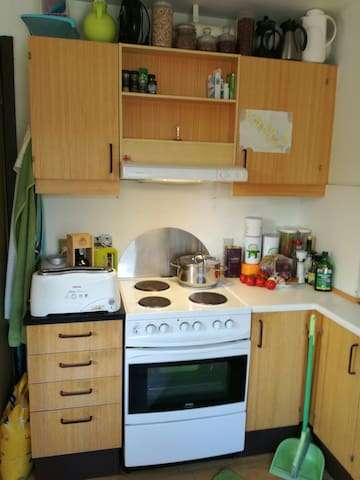 Kitchen with washer, fridge and microwave