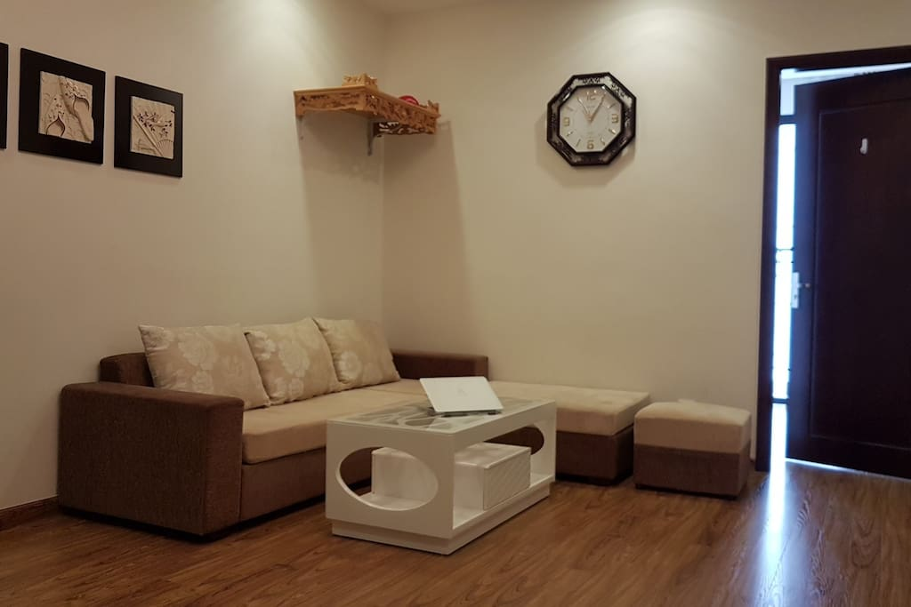 A cozy living room with comfortable beige sofas