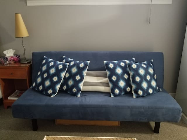 """This click-clack sofa is not suitable for people who are very tall.  It is perfect for anyone 5'8"""" and under and sleeps 2 people comfortably."""