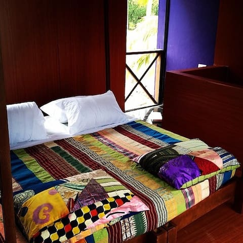Double bed with traditional woven silk spreads