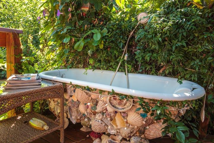 Seashell outdoor bathtub.