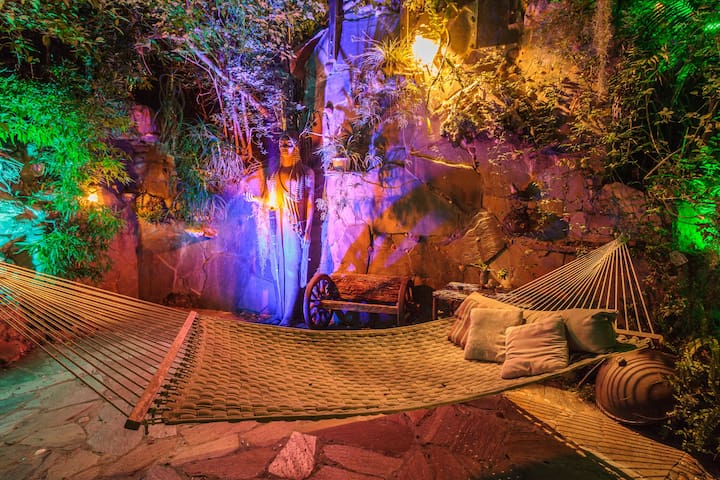 Main patio with hammocks during light show at night.