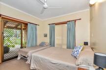 Main bedroom Queen/Single bed. Sliding door to front verandah