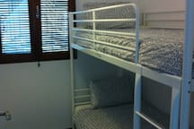 Small room with two beds (bunk bed).