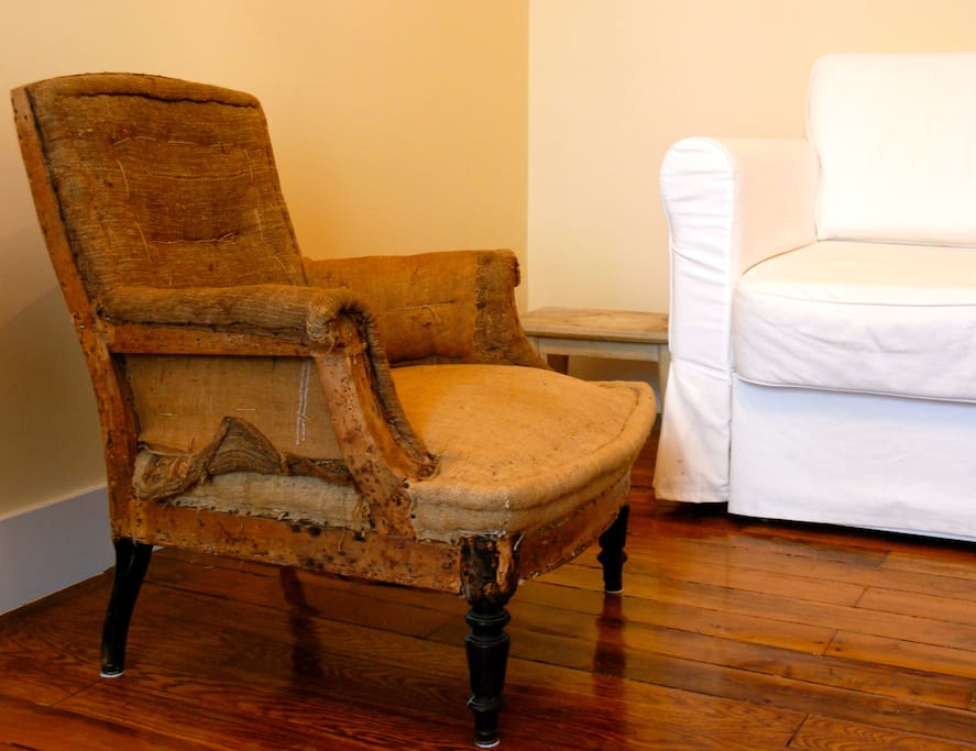 Living room. Antique armchair - yes, it's solid!