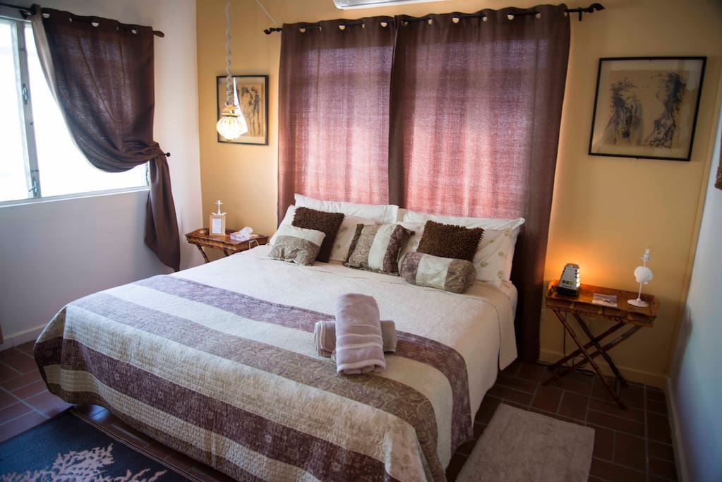 Bedroom with king bed and private bathroom.