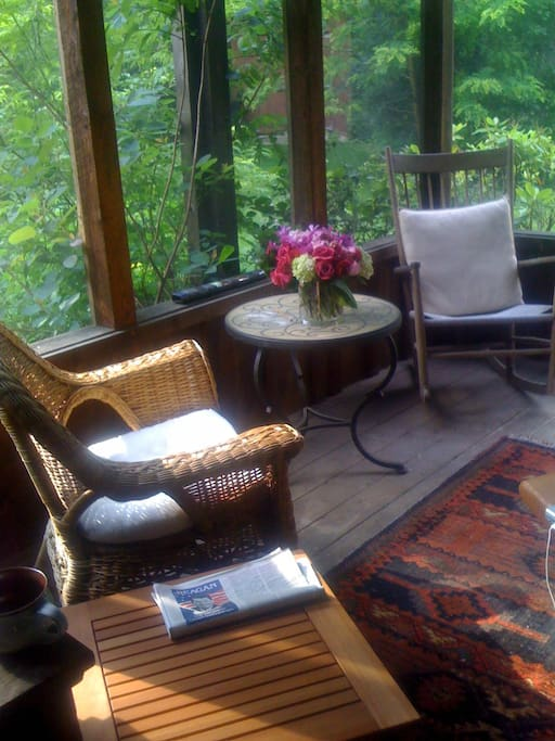 Enter the house through the Screened in sitting porch