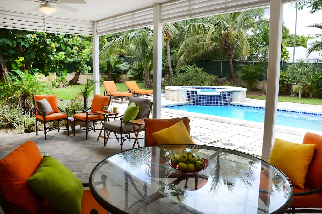 Lovely poolside veranda makes a great setting for meals or just having a lazy day with family and entertaining friends.