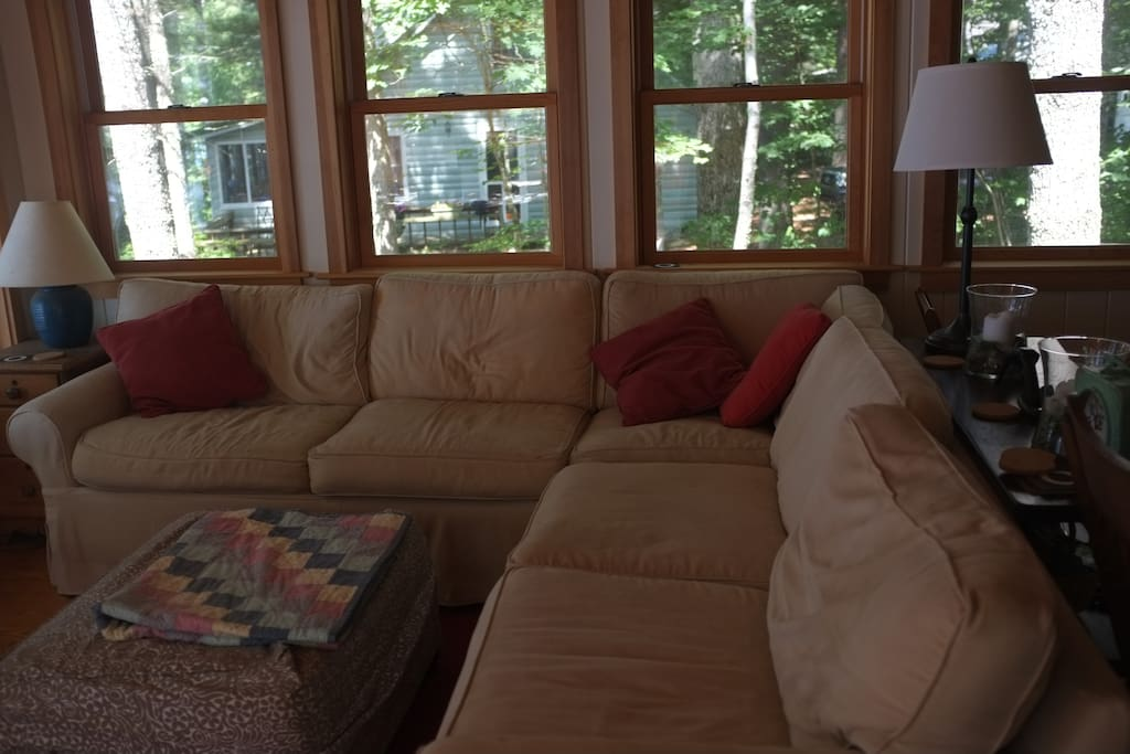 Sunroom couch facing lake.  Internet and cable TV