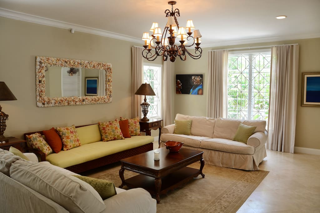 Spacious, cool and well appointed living room with lots of natural light